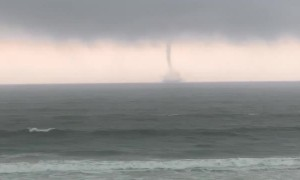 Friends Watching a Waterspout