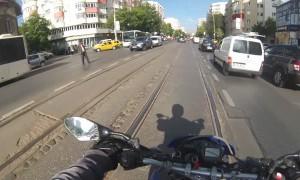 Biker Helps Senior Citizen Cross the Street
