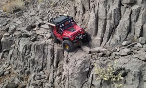 Red Jeep Traverses Across Sketchy Trail