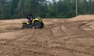Quad Rider Bounces off After Rough Landing
