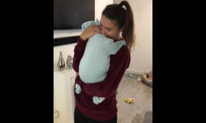 She appears to be holding a baby, but just wait for it!