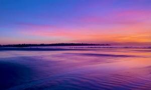 Spectacular Sunrise Reflects off Wet Sand
