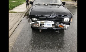 Truck Plows into Parked Car