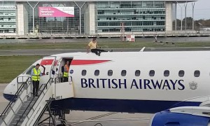 Man Sits on top of Plane at London City Airport