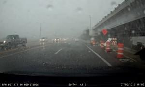 Sign Slams Car in High Winds