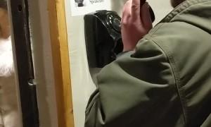 Man Opens Secret Door to Speakeasy