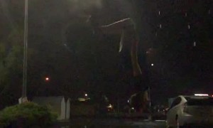 Landing a Backflip as the Lightning Strikes