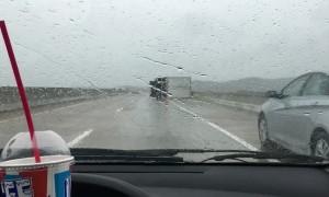 Strong Winds Tip Six Semi-Trucks over on One Bridge