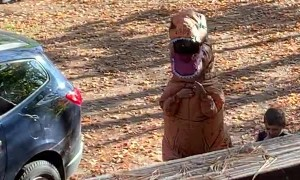 T-Rex Greets Kids School Bus