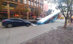 Sinkhole Swallows Up City Bus
