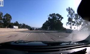 Truck's Wheel Goes Free on Freeway