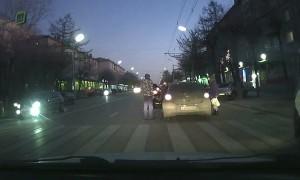 Pedestrian Pummelled by Car at Crossing