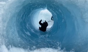 Sliding Through Glacial Ice Cave