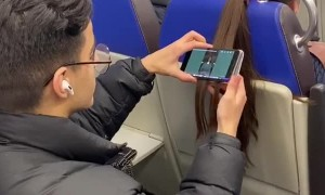 Passenger Hangs Phone From Hair