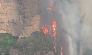 Fire in Australia filmed hugging cliffside like 'lava waterfall'
