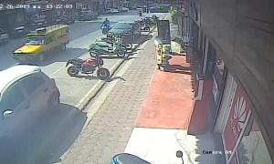 Street Eruption Injures Motorcyclist
