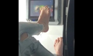 Disgusting passenger uses foot to swipe touch screen during flight