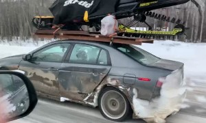 Cheap Car Carries Expensive Snowmobile