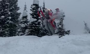 Snowmobile Jump Leads Directly Into Tree