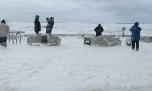 Foam Sneaker Wave Soaks Onlookers at Oregon Coast