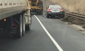 Truck Pushes Car Onto Freeway Shoulder