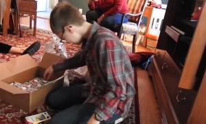 Child Cries Tears of Joy over Gaming Console for Christmas