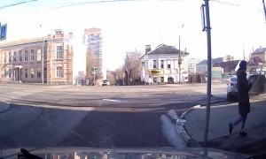 Colliding Cars Barely Miss Pedestrians