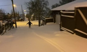 Heavy Snow Turns Streets Into Ski Slopes