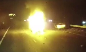 Truck Driver Rescues Woman From Burning Car