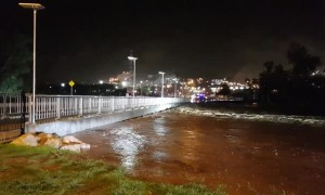 River Rises Rapidly Over Bridge After Heavy Rain