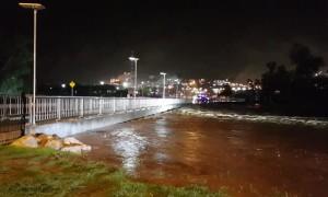 River Rises Rapidly Over Bridge After Heavy Rain
