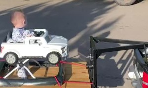 Tiny Car Towing Brother on Custom Trailer