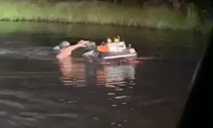 Guy Pushes Four-Wheeler Through the Pond