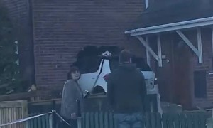 Car Stuck in the Side of a House