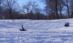 Snow Tubing Sledding Fail Mom slides into boy