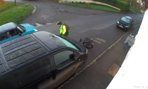 Cyclist Slips on Ice and Slams Car