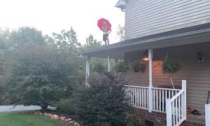Umbrella Makes Poor Parachute for Roof Jump