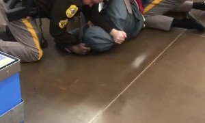 Police Officer Unloads Taser After Tussle