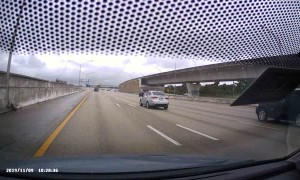 Car Hydroplanes Across All Lanes of Freeway in South Florida