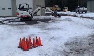 Scoring a Strike While Excavator Bowling