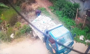 Truck Tumbles into a Pond