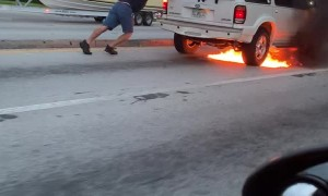 Person Gives Burning SUV a Push