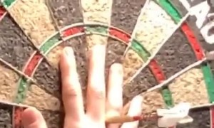Woman Throws a Perfect Bullseye in Darts Game