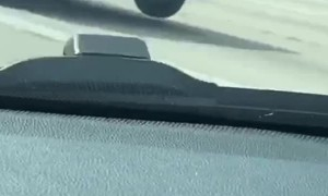 Back Tire Bounces Along Expressway