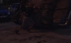 Strongman Picks Up a Car