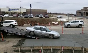 Sedan Gets Sunk in Wet Cement