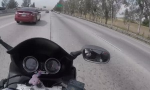 Merging Car Send Motorcycle Into Tiny Gap