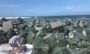 Kid Gets Swept off His Feet by Ocean