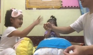 Daughters Play a Whimsical Game of Rock, Paper, Scissors With their Father