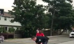 Super cool cop plays basketball with kids